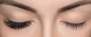 Woman with one eye of eyelash extensions and one eye without
